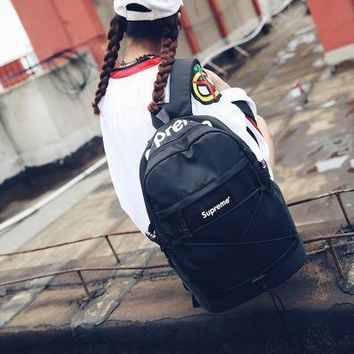 Trendy Black Supreme Printed Backpack School Bag