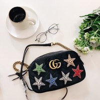 GUCCI GG Marmont velvet small shoulder bag with crystal embroidered star appliqués