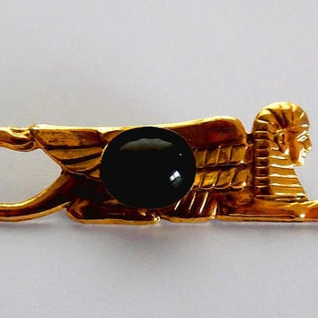 Goldtone egyptian sphinx brooch / polished metal / jet black black stone / glass cabachon / vintage / retro / gift / embossed / pin brooch