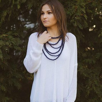 V-neck loose knit sweater - White