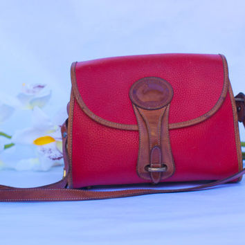 Vintage Dooney and Bourke Essex R-25 All Weather Leather, Medium Handbag In Red.