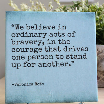 "Veronica Roth, Divergent quote decorative tile.. ""We believe in ordinary acts..."""