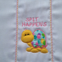 Spit Happens with a cute applique turtle in yellow, pinks, purple, and green for girls. It can be personalized for and extra charge.