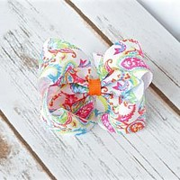 4 inch boutique style hair bows in an adorable preppy paisley 1 1/2 inch ribbon on an alligator clip, snap clip or barrette. Your Final Touch Hair Accessories