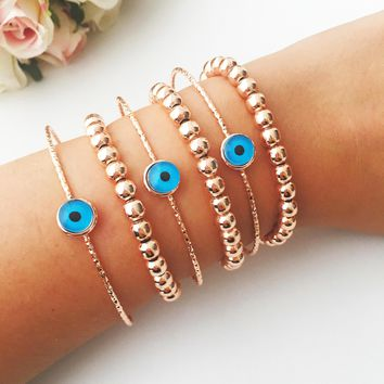 Rose gold beaded bracelet, evil eye bracelet, boho bracelet, layered bracelet, evil eye bangle bracelet