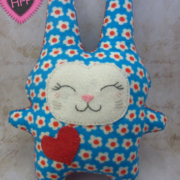 Soft bunny stuffed animal made with flower printed flannel - He has a kawaii face done in felt and a big read heart