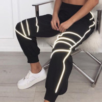 Hot style reflective striped slacks with cinched straps at the ankle