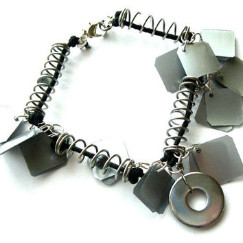 Upcycled bracelet in industrial style made of recycled plastic bottles, repurposed metal parts & found objects, black, silver, rock, techie