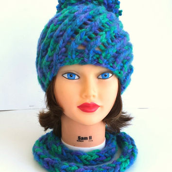 knit chunky swirl hat, beautiful warm, cosy beanie with big pompom and thin scarf around the neck.