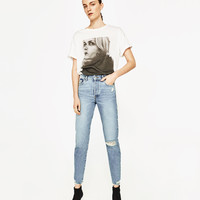 HIGH RISE JEANS WITH RIPS
