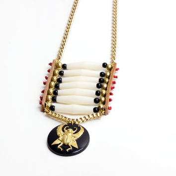 One of a kind. Breastplate scarab necklace, handmade by See Rue. Winged brass scarab. Wood pendant. gold chain