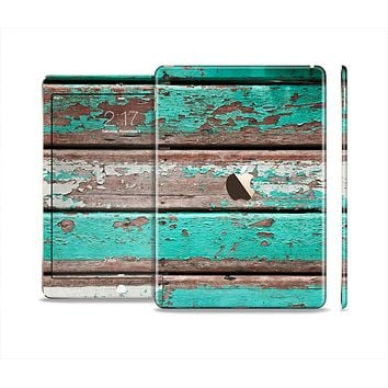 The Chipped Teal Paint On Wood Skin Set for the Apple iPad Air 2
