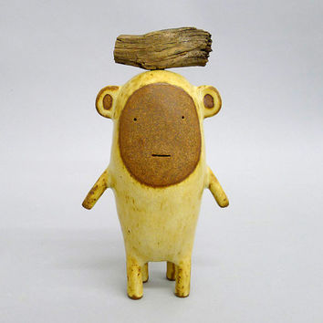 Small ceramic sculpture called Standing  Moute # 325