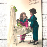 Antique french doll postcard - Two little girls, pyama's, doll, toy, cradle, hand tinted, art deco, 1920 1930
