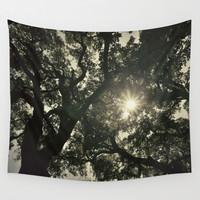 Sun through the big forest Wall Tapestry by Guido Montañés