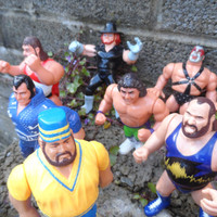 Vintage wrestling figures , 14 early WWF WCW action figures - vintage toys plastic 1990's Titan toys - undertaker ect old toys