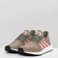 adidas Originals Swift Run Trainers In Khaki With Pink Stripe at asos.com