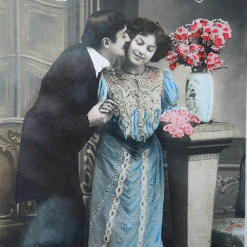 Antique french postcard - romantic couple kiss edwardian victorian lady blue dress, hand tinted, glossy, rppc, 1900 1910, vintage postcard