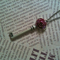 Ruddy rose key charm pendant necklace in antique bronze