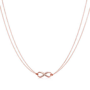 Tiffany & Co. - Tiffany Infinity pendant in RUBEDO® metal.