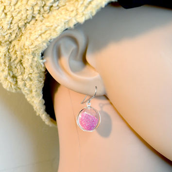 Candy pink fine glitter in round blown glass earrings.