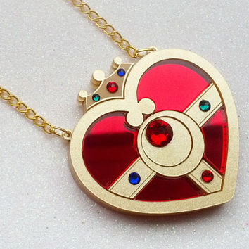 Cosmic Heart Compact Necklace: COSMIC HEART COMPACT Metallic Gold Laser Cut Acrylic Sailor Moon Necklace
