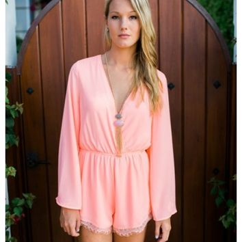 Katey - Long sleeve peach romper. Also available in mint.