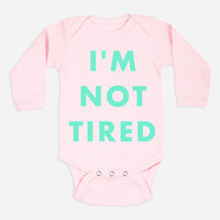 Hello Merch — I'm Not Tired (Babies) Pink Long Sleeve One-Piece with snaps