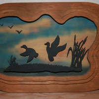 Wall Hanging of Ducks Flying Over a Pond of Reeds at Sunset