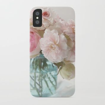 pink roses in blue jar iPhone Case by sylviacookphotography
