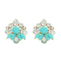Gold tone post earrings featuring crystal clear rhinestones and mint green cabochons