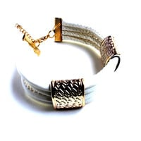 """""""Double Up"""" White Faux Leather Bracelet With Gold Accents"""