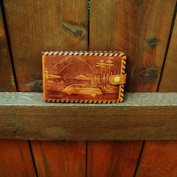 vintage hand tooled wallet.