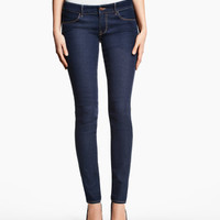 Low-rise jeans in washed stretch denim with ultra-slim legs