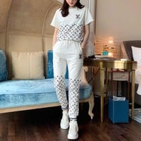 """ Louis Vuitton"" Woman Letter Casual Fashion Printing Short Sleeve Trousers Two-Piece Set Sportswear"