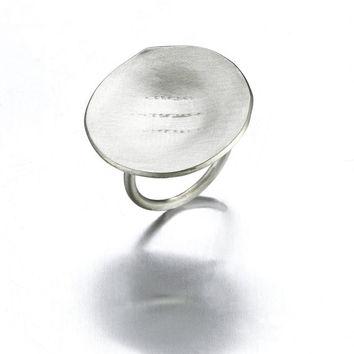 DOKU silver round shaped handmade designers ring with texture. Size 5 1/2