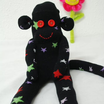 sock monkey, stuffed animal - black with colorful stars