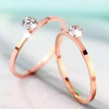 Refined version of the four - claw titanium - plated rose gold diamond ring, fashionable 100 - tie wedding proposal ring