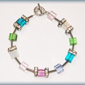 Springtime Bracelet .. sparkly pastel glass beads in pink, green, blue, aqua, purple and opalite, with rhinestones and a toggle clasp