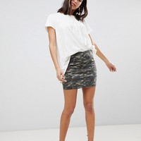 Free People Modern Femme camo print denim mini skirt at asos.com