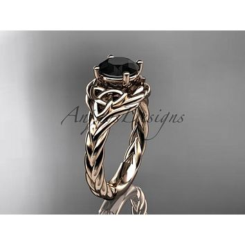 14kt rose gold celtic trinity twisted rope wedding ring with a Black Diamond center stone RPCT9125