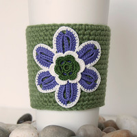 Crocheted coffee cozy, cup sleeve, appliqued purple flower, forest green center, beige trim, forest green sleeve, stocking stuffer