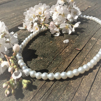 Pearl Choker Necklace. Authenthic-looking pearls measure 14 in. Beautiful and classy.