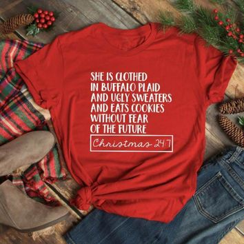 She Is Clothed in Buffalo Plaid Holiday Tee