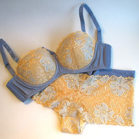 Balcony bra with padded cups and delicate lace push-up effect. Bridal lingerie. Honeymoon. Swarovski crystals