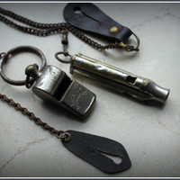 30s-40s police whistles with chains and leather button tabs. One being a tri tone custom made whistle.