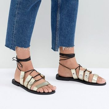 Sol Sana Divison Gold Sandals at asos.com