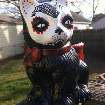 Calaveras cat planter with spider web mask and red bow