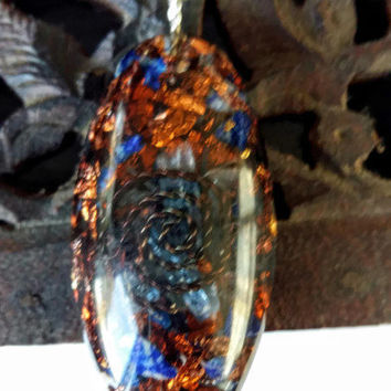 Blue and gold unsual oval pendant on a silver chain