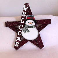 Snowman Welcome Sign On A Wooden Star